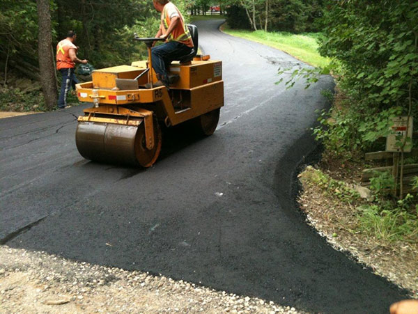 Smoothing a new asphalt driveway